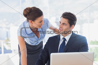 Business people look at each other and smiling