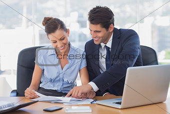 Smiling business people working together