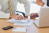 Businessmen going over paperwork