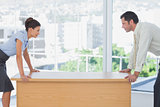 Business people facing off at desk