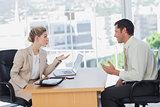 Businesswoman interviewing a smiling businessman