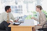 Businessman interviewing a businesswoman