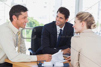 Business people smiling during a meeting