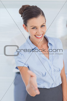 Business woman giving her hand for handshake