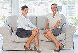 Business women sitting on the couch