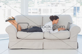 Business woman lying on couch