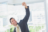 Businessman raising up his hand