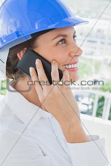 Smiling architect having a phone conversation