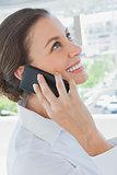 Smiling businesswoman having a phone conversation