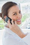 Cheerful businesswoman having a phone conversation