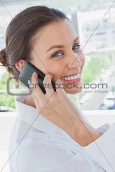 Cheerful businesswoman having a phone conversation