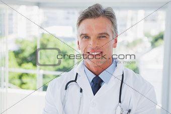 Charismatic doctor standing
