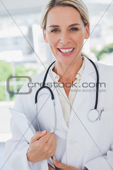 Attractive doctor standing with a clipboard