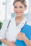 Radiant nurse holding a folder