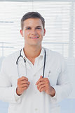 Young doctor holding his stethoscope