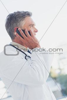 Attractive doctor phoning