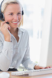 Smiling businesswoman talking on headset