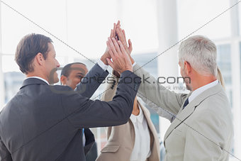 Business team high fiving