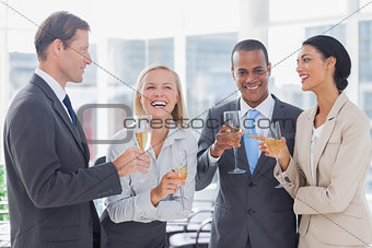 Business team celebrating with champagne