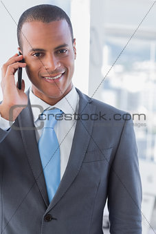 Smiling businessman on a call