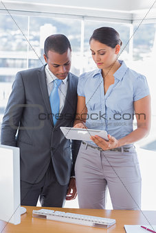 Business team looking at digital tablet