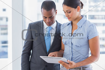Business team looking at tablet computer