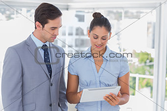Business team looking at tablet pc