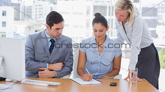 Business team working with a notepad