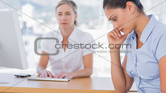 Anxious businesswoman holding her head