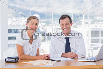 Smiling business people posing together