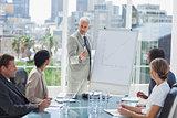 Serious businessman giving a presentation