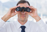 Close up of businessman using binoculars