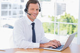 Cheerful businessman wearing a headset