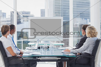 Group of business people looking at a screen