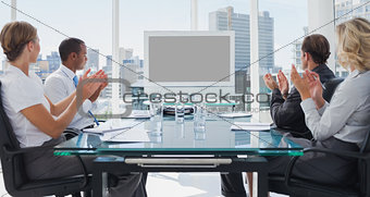 Business people applauding during a video conference