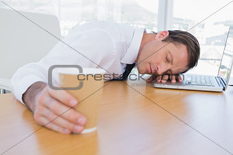 Asleep businessman on his laptop