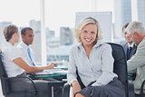 Attractive businesswoman posing in the boardroom