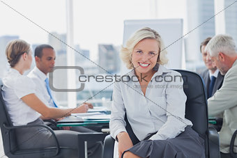 Attractive businesswoman posing in the boardroom
