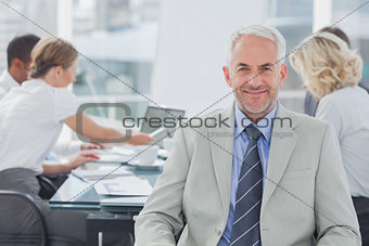 Charismatic businessman posing in the boardroom