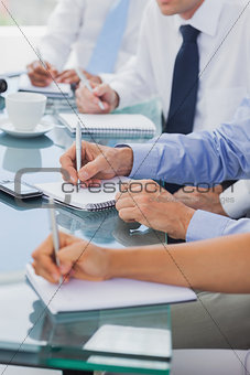 Business people hands taking notes