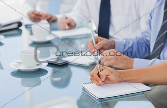 Business people hands taking some notes