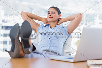 Attractive businesswoman having a nap