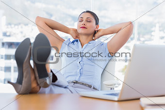 Attractive businesswoman relaxing in her office