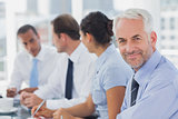 Smiling businessman posing in the meeting room