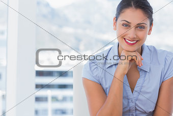 Attractive businesswoman sitting at her desk