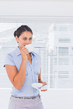 Attractive businesswoman drinking coffee