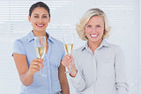 Attractive businesswomen drinking champagne