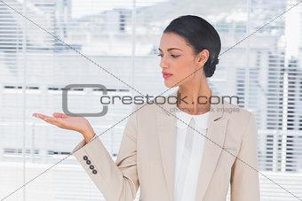 Attractive businesswoman opening her hand