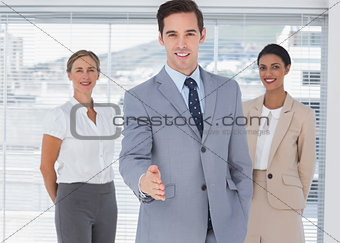 Attractive businessman offering his hand