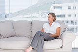 Businesswoman sitting on couch